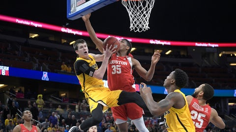 <p>               FILE - In this Saturday, March 10, 2018, file photo, Wichita State guard Austin Reaves (12) is fouled by Houston forward Fabian White Jr. (35) while going up for a shot during the second half of an NCAA college basketball game in the semifinals at the American Athletic Conference tournament in Orlando, Fla. Reaves is preparing for a big role with Oklahoma after transferring from Wichita State and sitting out last season. (AP Photo/Phelan M. Ebenhack, File)             </p>