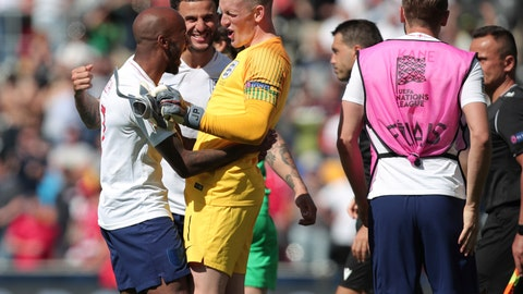 <p>               England's Fabian Delph, England's Kyle Walker, England goalkeeper Jordan Pickford celebrate after the winning at the end the UEFA Nations League third place soccer match between Switzerland and England at the D. Afonso Henriques stadium in Guimaraes, Portugal, Sunday, June 9, 2019. (AP Photo/Luis Vieira)             </p>