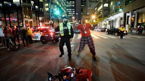 <p>               A police officer and a fan dance in the street after the Toronto Raptors defeated the Golden State Warriors during Game 6 NBA Finals to win the NBA Championship, in Toronto on Friday, June 14, 2019. (Nathan Denette/The Canadian Press via AP)             </p>