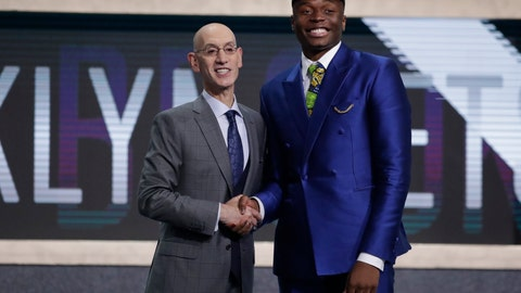 <p>               NBA Commissioner Adam Silver poses for photographs with Florida State's Mfiondu Kabengele after the Brooklyn Nets selected him as the 27th pick overall in the NBA basketball draft Thursday, June 20, 2019, in New York. (AP Photo/Julio Cortez)             </p>