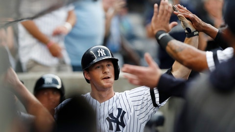 <p>               New York Yankees' DJ LeMahieu celebrates with teammates after hitting a solo home run during the first inning of the team's baseball game against the Toronto Blue Jays, Tuesday, June 25, 2019, in New York. With the home run, the Yankees broke a record in the majors for consecutive games with a home run. (AP Photo/Kathy Willens)             </p>