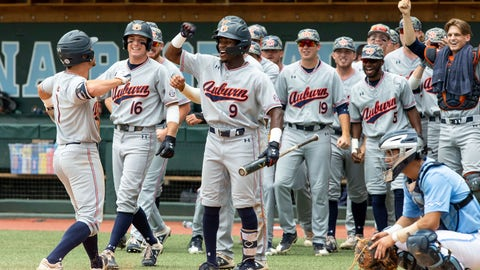 <p>               Auburn's Judd Ward (1) celebrates with Ryan Bliss (9) and teammates after hitting a home run during an NCAA super-regional baseball game against North Carolina in Chapel Hill, N.C., Monday, June 10, 2019. (AP Photo/Ben McKeown)             </p>