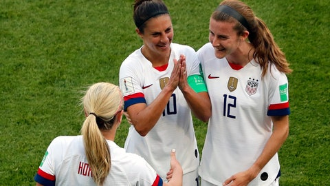 <p>               United States' Carli Lloyd, center, celebrates with Lindsey Horan and Tierna Davidson, right, after scoring the opening goal during the Women's World Cup Group F soccer match between the United States and Chile at the Parc des Princes in Paris, Sunday, June 16, 2019. (AP Photo/Thibault Camus)             </p>