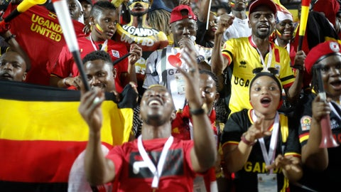 <p>               Ugandan fans cheer before the African Cup of Nations group A soccer match between Egypt and Uganda in Cairo International Stadium in Cairo, Egypt, Sunday, June 30, 2019. (AP Photo/Ariel Schalit)             </p>