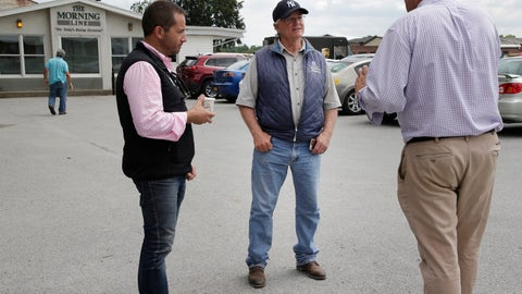 <p>               Trainer Bill Mott, second from right, stops to talk to people at Belmont Park in Elmont, N.Y., Thursday, June 6, 2019. The 151st Belmont Stakes horse race will be run on Saturday, June 8, 2019. (AP Photo/Seth Wenig)             </p>