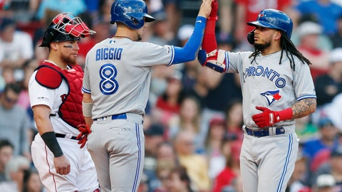<p>               Toronto Blue Jays' Freddy Galvis, right, celebrates his two-run home run that drove in Cavan Biggio (8) as Boston Red Sox's Christian Vazquez stands near the plate during the seventh inning of a baseball game in Boston, Saturday, June 22, 2019. (AP Photo/Michael Dwyer)             </p>