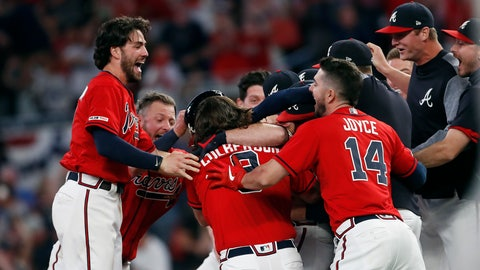 <p>               Atlanta Braves mob Brian McCann after he hit a two-run single in the ninth inning of a baseball game to defeat Philadelphia Phillies 9-8 Friday, June 14, 2019, in Atlanta. (AP Photo/John Bazemore)             </p>