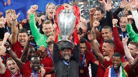 <p>               Liverpool coach Juergen Klopp lifts up the trophy as he celebrates with players after winning the Champions League final soccer match between Tottenham Hotspur and Liverpool at the Wanda Metropolitano Stadium in Madrid, Saturday, June 1, 2019. (AP Photo/Armando Franca)             </p>