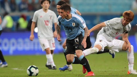 <p>               Uruguay's Lucas Torreira, center, and Japan's Kou Itakura fight for the ball during a Copa America Group C soccer match at the Arena Gremio in Porto Alegre, Brazil, Thursday, June 20, 2019. (AP Photo/Edison Vara)             </p>