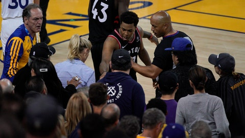 <p>               Toronto Raptors guard Kyle Lowry, middle, gestures next to referee Marc Davis (8) near the front row of fans during the second half of Game 3 of basketball's NBA Finals between the Golden State Warriors and the Raptors in Oakland, Calif., Wednesday, June 5, 2019. A fan seated courtside for Game 3 of the NBA Finals was ejected after shoving Lowry when the Raptors star crashed into a row of seats while trying to save a ball from going out of bounds on Wednesday night. (AP Photo/Tony Avelar)             </p>