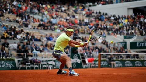 <p>               Spain's Rafael Nadal plays a shot against Switzerland's Roger Federer during their semifinal match of the French Open tennis tournament at the Roland Garros stadium in Paris, Friday, June 7, 2019. (AP Photo/Christophe Ena)             </p>