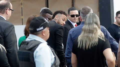 <p>               Brazilian soccer star Neymar, center, arrives to a police station to testify, after a woman accused him of rape, in Sao Paulo, Brazil, Thursday, June 13, 2019. Neymar denies any wrongdoing. (AP Photo/Andre Penner)             </p>