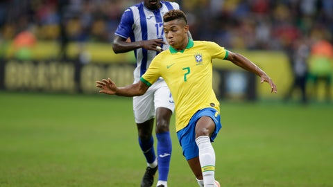<p>               Brazil's David Neres, front, dribbles past Honduras' Alberth Elis during a friendly soccer match at the Beira Rio stadium in Porto Alegre, Brazil, Sunday, June 9, 2019. Brazil opens the Copa America tournament next Friday against Bolivia in Sao Paulo. (AP Photo/Edison Vara)             </p>