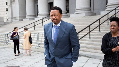 <p>               Former Oklahoma State assistant basketball coach Lamont Evans leaves after his sentencing in Federal Court June 7, 2019, in New York. Evans is one of four convicted in a scheme to pay coaches and families of top-tier players to choose favored managers and financial advisors. (AP Photo/Kevin Hagen)             </p>
