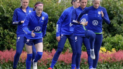 <p>               US player Megan Rapinoe, front right, stretches with Ali Krieger and other team members during a US womens soccer team training session at the Tottenham Hotspur training centre in London, Thursday, June 6, 2019. The Women's World Cup starts in France on June 7. (AP Photo/Kirsty Wigglesworth)             </p>