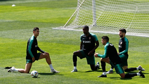 <p>               From left, Portugal's Cristiano Ronaldo, William Carvalho, Joao Cancelo and Rafa Silva stretch during a soccer training session at the Bessa stadium in Porto, Portugal, Friday, June 7, 2019. Portugal will play Netherlands in the UEFA Nations League final on Sunday. (AP Photo/Armando Franca)             </p>