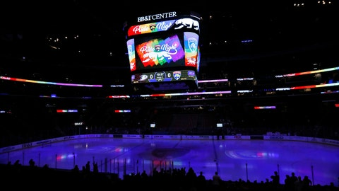 """<p>               In this Feb. 3, 2017, photo, the scoreboard shows """"Pride Night,"""" before the start of an NHL hockey game between the Florida Panthers and the Anaheim Ducks in Sunrise, Fla. Researchers say a survey of players in the Australian Ice Hockey League shows homophobic language is often used but that an even higher percentage of competitors would make a gay player feel welcome. (AP Photo/Wilfredo Lee)             </p>"""