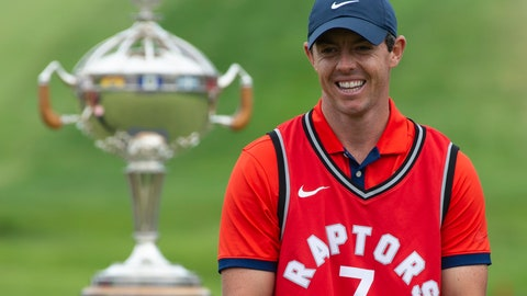<p>               Rory McIlroy laughs as he puts on a Toronto Raptors jersey during the trophy presentation at the Canadian Open golf championship in Ancaster, Ontario, on Sunday, June 9, 2019. (Adrian Wyld/The Canadian Press via AP)             </p>