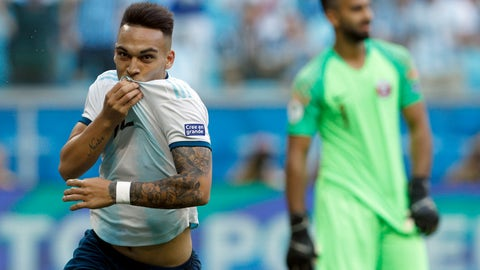 <p>               Argentina's Lautaro Martinez, left, celebrates scoring against Qatar during a Copa America Group B soccer match at Arena do Gremio, Porto Alegre, Brazil, Sunday, June 23, 2019. Argentina won 2-0 to reach the Copa America quarterfinals and avoid being eliminated in the group stage of the South American tournament for the first time since 1983. (AP Photo/Victor R. Caivano)             </p>