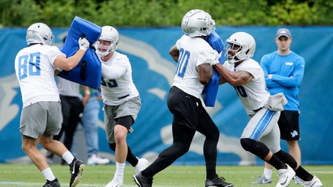 <p>               Detroit Lions tight ends T.J. Hockenson, from left, blocks against Jesse James while Michael Roberts (80) blocks against Jerome Cunningham during NFL football training camp Wednesday, June 5, 2019, in Allen Park, Mich. (AP Photo/Duane Burleson)             </p>