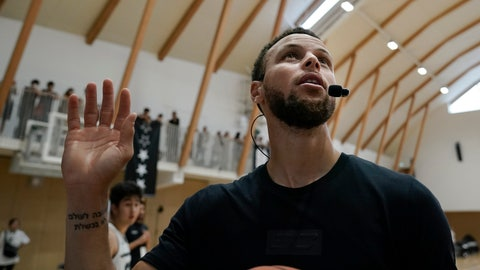 <p>               Golden State Warriors' Stephen Curry waves toward the fans while coaching at a high school basketball camp Sunday, June 23, 2019, in Tokyo. Curry is already looking ahead to the next challenge in his basketball career, including the chance to represent the United States at next year's Tokyo Olympics. (AP Photo/Jae C. Hong)             </p>