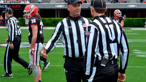 <p>               In this April 20, 2019 photo, Tom Quick talks with a colleague during Georgia's spring NCAA college football game in Athens, Ga. They're jobs have never been more difficult. Those who do it face relentless, often uninformed criticism, and attacks on their credibility. (Gary McGriff via AP)             </p>