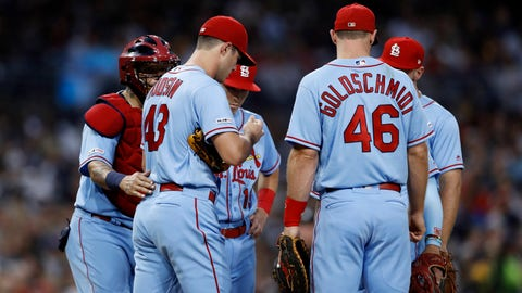 St. Louis Cardinals catcher Yadier Molina, left, has a word with starting pitcher Dakota Hudson, second from left, as infielders join them on the mound during the second inning of the team's baseball game against the San Diego Padres, Saturday, June 29, 2019, in San Diego. (AP Photo/Gregory Bull)