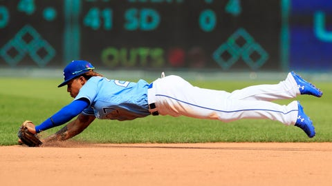 Kansas City Royals shortstop Adalberto Mondesi fields a ground ball hit by Chicago White Sox's Yoan Moncada (10) during the ninth inning of a baseball game at Kauffman Stadium in Kansas City, Mo., Sunday, June 9, 2019. Moncada earned a hit on the play. (AP Photo/Orlin Wagner)