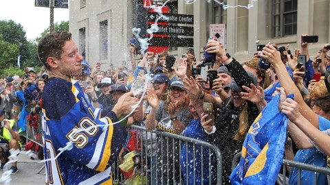 St. Louis Blues goaltender Jordan Binnington celebrates with fans during the NHL hockey Stanley Cup victory celebration, Saturday, June 15, 2019, in St. Louis. (AP Photo/Scott Kane)