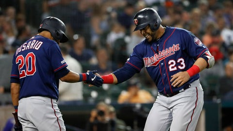 Minnesota Twins' Nelson Cruz (23) celebrates his solo home run with Eddie Rosario (20) during the eighth inning of the team's baseball game against the Detroit Tigers in Detroit, Friday, June 7, 2019. (AP Photo/Paul Sancya)