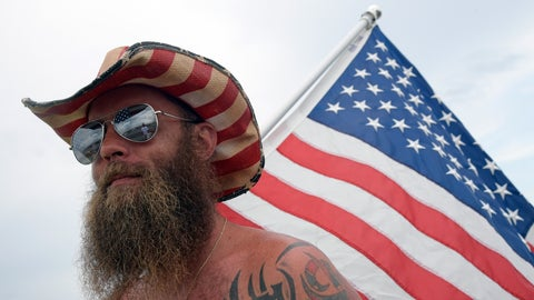 <p>               Tony Pacetti walks around the infield with a United States flag before a NASCAR Cup Series auto race at Daytona International Speedway, Saturday, July 6, 2019, in Daytona Beach, Fla. (AP Photo/Phelan Ebenhack)             </p>