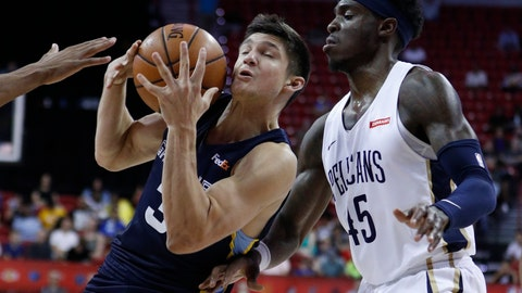 <p>               Memphis Grizzlies' Grayson Allen drives into New Orleans Pelicans' Zylan Cheatham during the second half of an NBA summer league basketball game Sunday, July 14, 2019, in Las Vegas. (AP Photo/John Locher)             </p>