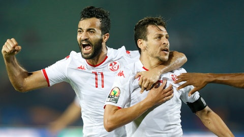 <p>               Tunisia's Youssef Msakni, right and Tunisia's Taha Khenissi celebrate after scoring during the African Cup of Nations quarterfinal soccer match between Madagascar and Tunisia in Al Salam stadium in Cairo, Egypt, Thursday, July 11, 2019. (AP Photo/Ariel Schalit)             </p>