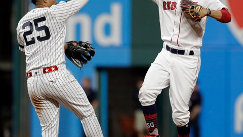 <p>               American League Gleyber Torres, left, of the New York Yankees, and American League Mookie Betts, of the Boston Red Sox, celebrate a 4-3 victory of the National League in the MLB baseball All-Star Game, Tuesday, July 9, 2019, in Cleveland. (AP Photo/Tony Dejak)             </p>