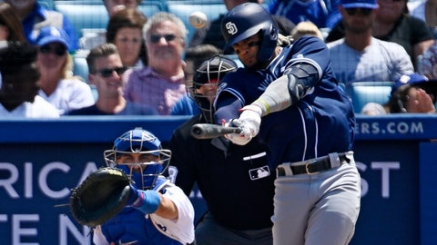 <p>               San Diego Padres' Fernando Tatis Jr., right, hits a three-run home run as Los Angeles Dodgers catcher Austin Barnes watches during the fifth inning of a baseball game Sunday, July 7, 2019, in Los Angeles. (AP Photo/Mark J. Terrill)             </p>
