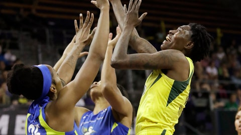 <p>               Seattle Storm's Natasha Howard, right, and Dallas Wings' Glory Johnson (25) reach for the ball during the first half of a WNBA basketball game Friday, July 12, 2019, in Seattle. (AP Photo/Elaine Thompson)             </p>