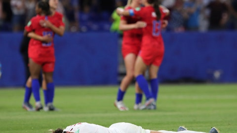 <p>               England's Lucy Bronze lies on the pitch in dejection at the end of the Women's World Cup semifinal soccer match between England and the United States, at the Stade de Lyon outside Lyon, France, Tuesday, July 2, 2019. (AP Photo/Laurent Cipriani)             </p>
