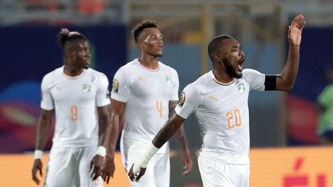 <p>               Ivory Coast's Die Serey, right, celebrates with teammates after scoring his side's second goal during the African Cup of Nations group D soccer match between Namibia and Ivory Coast in 30 June Stadium in Cairo, Egypt, Monday, July 1, 2019. (AP Photo/Hassan Ammar)             </p>