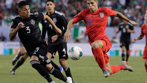 <p>               United States midfielder Christian Pulisic, right, controls the ball against Mexico defender Carlos Salcedo during the first half of the CONCACAF Gold Cup final soccer match at Soldier Field in Chicago, Sunday, July 7, 2019. (AP Photo/Nam Y. Huh)             </p>