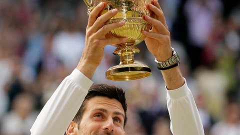 <p>               Serbia's Novak Djokovic lifts the trophy after defeating Switzerland's Roger Federer in the men's singles final match of the Wimbledon Tennis Championships in London, Sunday, July 14, 2019. (AP Photo/Tim Ireland)             </p>
