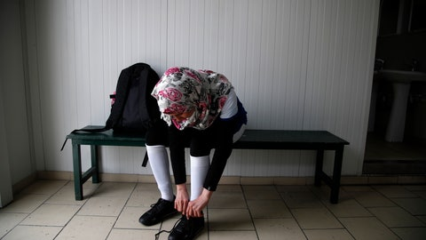 <p>               In this Wednesday, April 24, 2019 photo, Hiba from Iraq prepares for a training session of Hestia FC Women's Refugee Soccer team in Athens. Many of the players at Hestia FC weren't allowed to play or even watch soccer matches in their home countries. Hestia FC was set up by the Olympic Truce Centre, a non-government organization created in 2000 by the International Olympic Committee and Greek Foreign Ministry. (AP Photo/Thanassis Stavrakis)             </p>