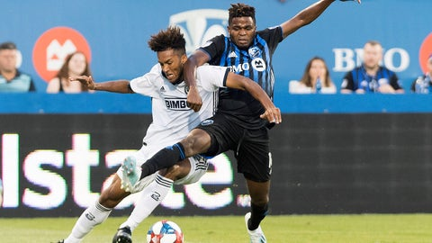 <p>               Montreal Impact's Orji Okwonkwo, right, challenges Philadelphia Union's Auston Trusty during the first half of an MLS soccer game, Saturday, July 27, 2019 in Montreal. (Graham Hughes/The Canadian Press via AP)             </p>