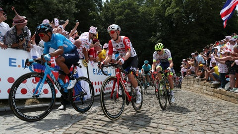 <p>               The pack with Colombia's Nairo Quintana, left, and Belgium's Jasper De Buyst, center, climb Mur De Grammont during the first stage of the Tour de France cycling race over 194.5 kilometers (120,86 miles) with start in Brussels and finish in Brussels, Saturday, July 6, 2019. (AP Photo/Thibault Camus)             </p>