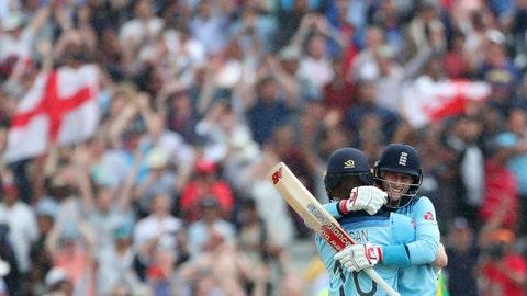 <p>               England's captain Eoin Morgan, left, hugs teammate Joe Root to celebrate their win over Australia in the Cricket World Cup semi-final match at Edgbaston in Birmingham, England, Thursday, July 11, 2019. (AP Photo/Aijaz Rahi)             </p>