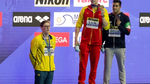 <p>               China's Sun Yang, centre, holds up his gold medal as silver medalist Australia's Mack Horton, left, stands away from the podium and bronze medalist Italy's Gabriele Detti after the men's 400m freestyle final at the World Swimming Championships in Gwangju, South Korea, Sunday, July 21, 2019. (AP Photo/Mark Schiefelbein)             </p>