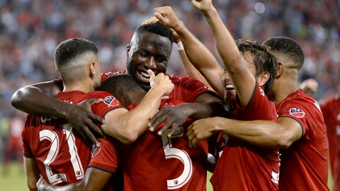 <p>               Toronto FC defender Ashtone Morgan (5) gets mobbed by teammates after scoring against the New York Red Bulls during the second half of an MLS soccer match Wednesday, July 17, 2019, in Toronto. (Nathan Denette/The Canadian Press via AP)             </p>