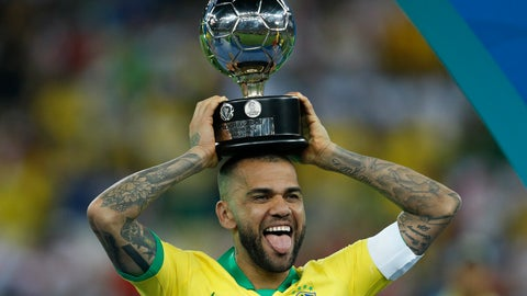 <p>               Brazil's Dani Alves celebrates with the trophy for best player of the tournament after Brazil's 3-1 victory over Peru in the final soccer match of the Copa America at the Maracana stadium in Rio de Janeiro, Brazil, Sunday, July 7, 2019. (AP Photo/Victor R. Caivano)             </p>