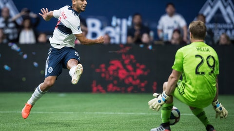 <p>               Vancouver Whitecaps' Ali Adnan, left, is stopped by Sporting Kansas City goalkeeper Tim Melia during the second half of an MLS soccer match Saturday, July 13, 2019, in Vancouver, British Columbia. (Darryl Dyck/The Canadian Press via AP)             </p>