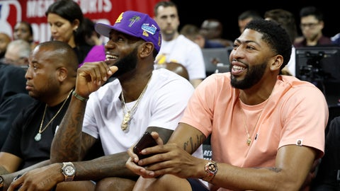 <p>               Los Angeles Laker players LeBron James, center, and Anthony Davis, right, take in an NBA summer league basketball game between the New York Knicks and the New Orleans Pelicans, Friday, July 5, 2019, in Las Vegas. (AP Photo/Steve Marcus)             </p>