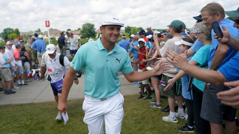 <p>               Bryson DeChambeau greets fans as he leaves the ninth hole during the second round of the 3M Open golf tournament in Blaine, Minn., Friday, July 5, 2019. (Jerry Holt/Star Tribune via AP)             </p>
